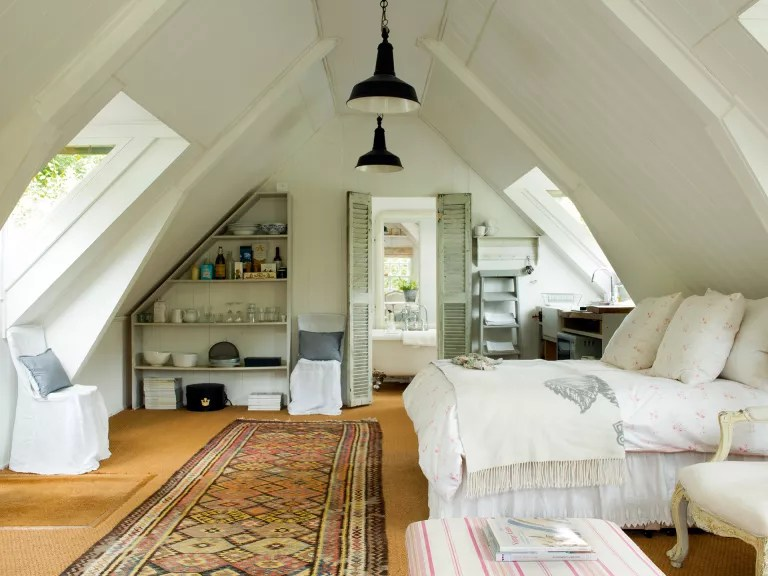 light bedroom in an attic in cottage bedroom style