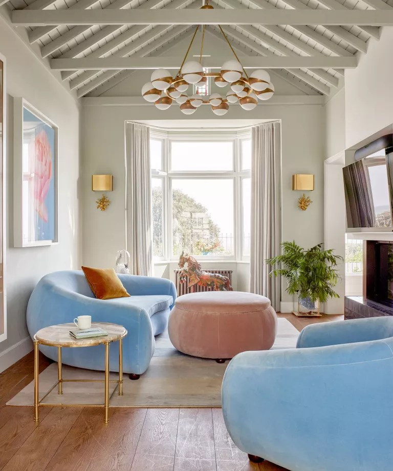 Neutral living room with blue sofa and tv