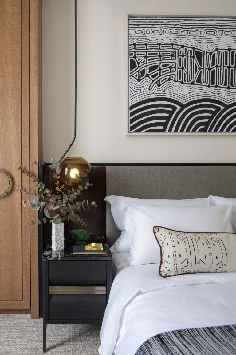 tribal art above bed in bedroom by Kitesgrove