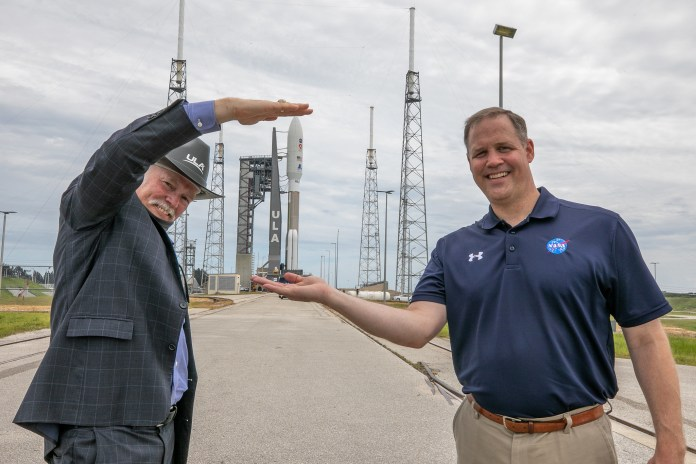 NASA Administrator Jim Bridenstine, at right, and Tory Bruno, CEO of United Launch Alliance (ULA), watch the rollout of the ULA Atlas V 541 rocket, carrying NASA's Mars Perseverance rover and Ingenuity helicopter, as it rolls along to the launch pad at Space Launch Complex 41 at Cape Canaveral Air Force Station on July 28, 2020.