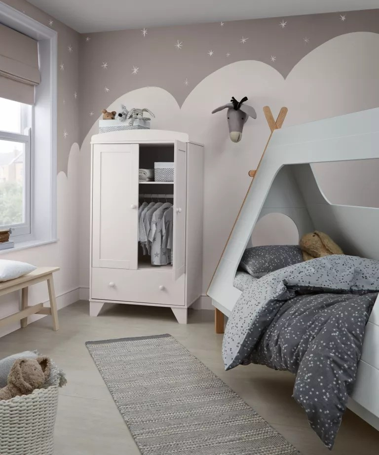 A child's bedroom with wall mural depicting a snowy landscape