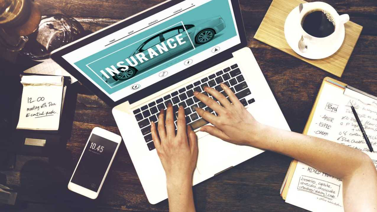 Car insurance internet site viewing on laptop