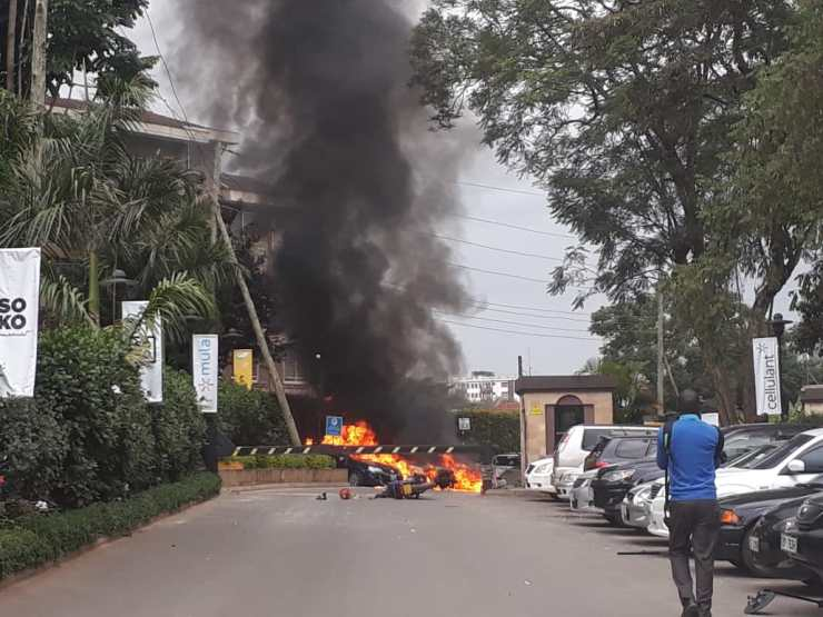 Vehicles burning at the entrance of Desut hotel...explosives can be heard