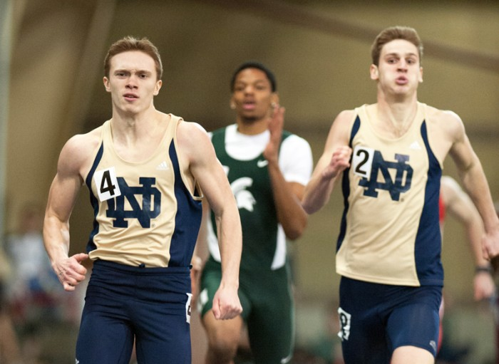 Freshman Harvey Smith, left, runs during the Notre Dame Invitational on Saturday. Smith is one of the Irish freshmen off to a strong start in 2014.