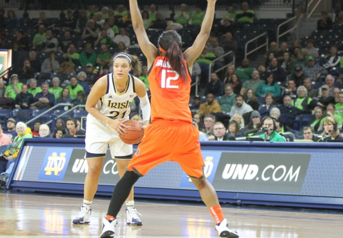 Senior forward Kayla McBride looks for a pass while defended by Miami senior guard Krystal Saunders on Jan. 23. McBride picked up a double-double with 23 points and 11 rebounds against Duke on Sunday.
