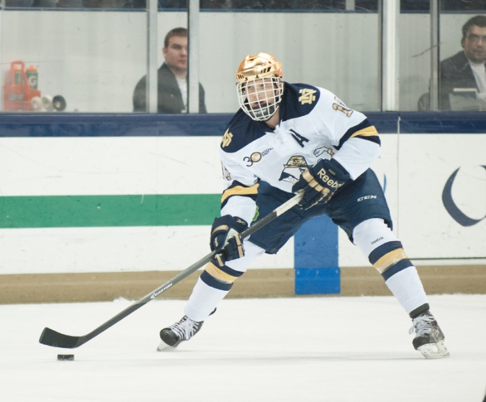 Senior center and alternate captain T.J. Tynan looks for an opening in Notre Dame's 4-0 loss to Northeastern on Jan. 24.