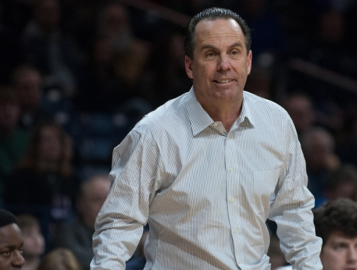 Irish coach Mike Brey observers his team's game against Boston      College on Saturday. Notre Dame took the 76-73 victory in overtime.