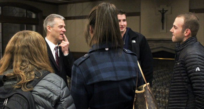 Professor of finance Carl Ackermann talks with students following his speech on Tuesday evening in the Last Lecture series.