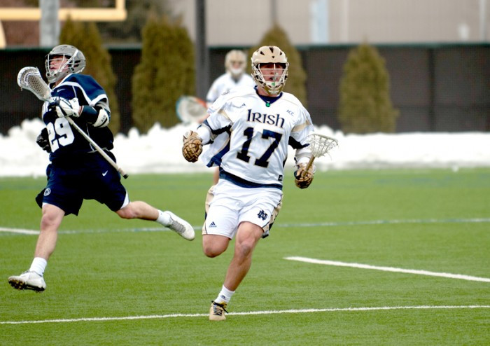 Junior midfielder Will Corrigan runs downfield in Notre Dame's 8-7 loss to Penn State on Saturday at Arlotta Stadium.