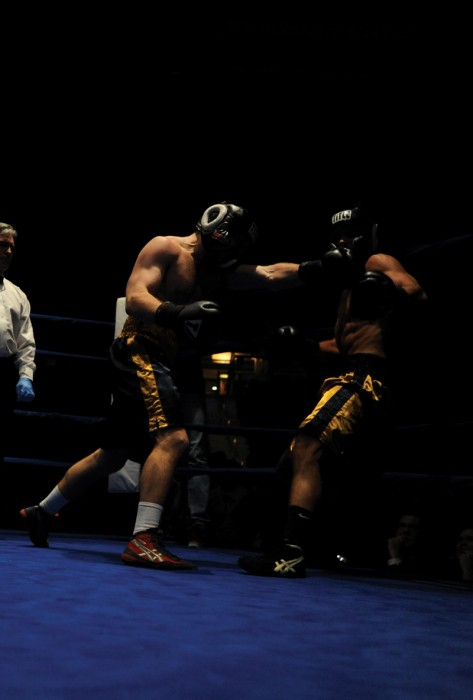 Former Irish boxer and captain Ryan Alberdi, left, lands a left hook in last year's 185-pound final. Alberdi now coaches young boxers.