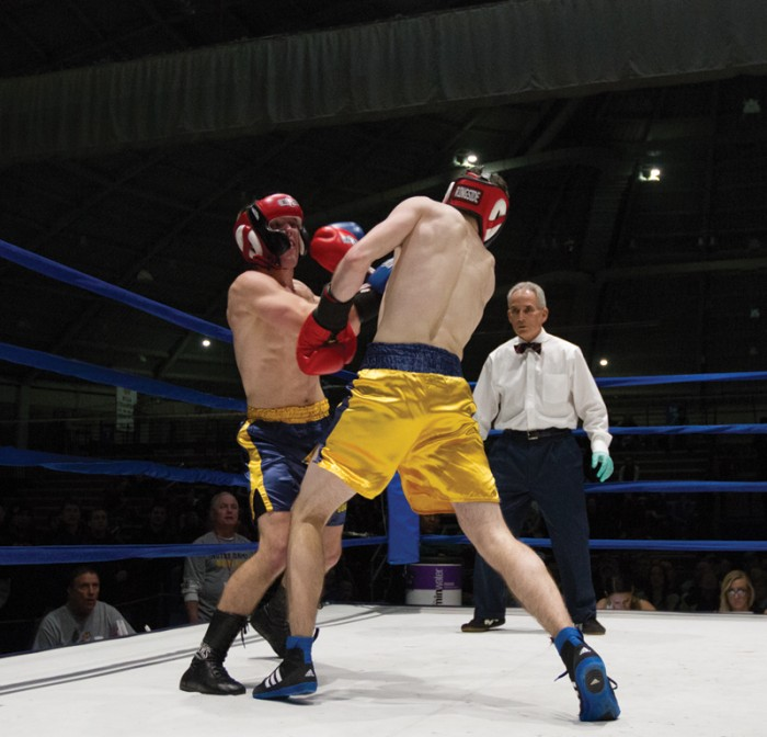 Senior captain Niels Seim, left, punches his way past the defense of freshman Patrick Brennan, in the semifinal round.
