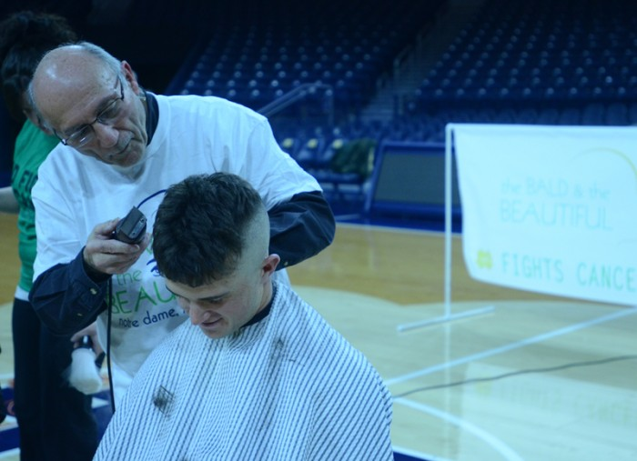 Sophomore pitcher Michael Hearne receives a haircut as part of a fundraiser for cancer research. The entire Irish program took part.