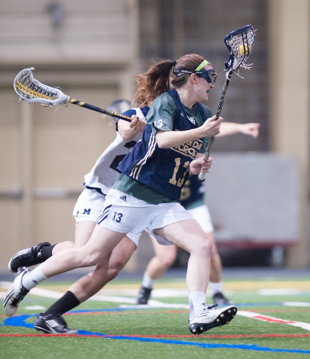 Notre Dame junior midfielder Caitlin Gargan carries the ball for Notre Dame while she looks to score during Notre Dame's 19-7 scrimmage win over Michigan on Saturday. Gargan returns as one of the last season's top scorers, as she finished 2013 with 19 goals and five assists for the Irish.
