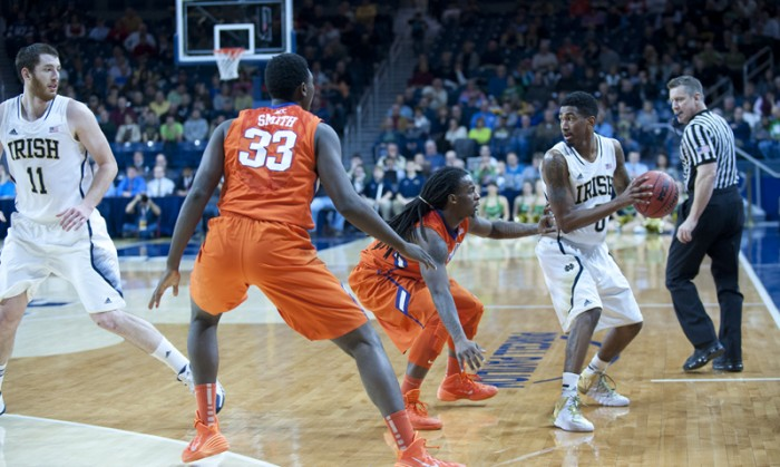 Senior guard Eric Atkins looks to pass to a teammate during Notre Dame's 68-64 double overtime win over Clemson on Feb. 11.