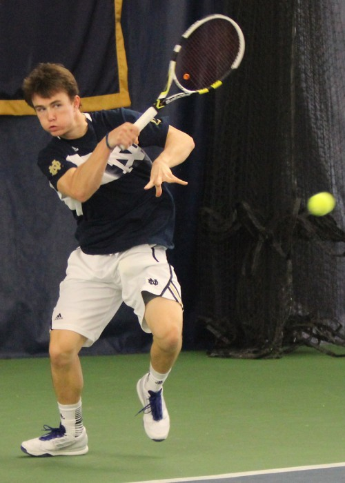 Irish senior Greg Andrews hits a shot during Notre Dame's 4-2 loss to Ohio State on Saturday in the Eck Tennis Center.