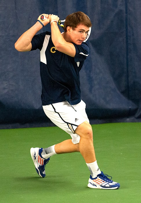 Senior captain Greg Andrews returns a shot against Kentucky's Tom Jomby (not pictured) on Feb. 2 at the Eck Tennis Pavilion. Andrews and the Irish take on Northwestern today at the Combe Tennis Center in Evanston, Ill.