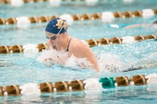 Junior Emma Reaney during the breaststroke section of the Women's 200IM breaks a pool record.
