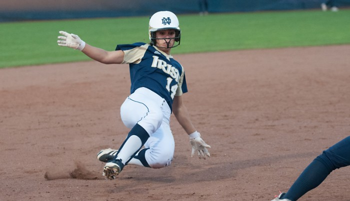 Irish senior outfielder Monica Torres slides into third base ahead of the throw during a scrimmage on Oct. 9, 2013.