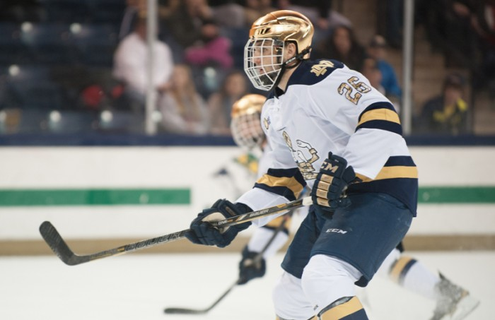 Senior defenseman Kevin Lind watches the puck during Notre Dame's 4-0 loss to Northeastern at the Compton Family Ice Arena on Jan. 24. The irish went 5-0-1 in their last six games before the post-season begins Friday.
