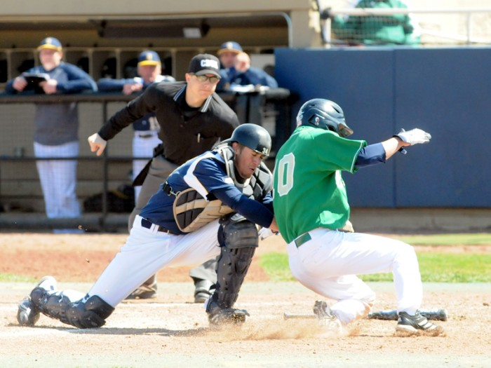 Irish junior Conor Biggio attempts to avoid the tag at the plate against Quinnipac on April 21, 2013, when Notre Dame claimed a 5-1 victory. This season, Biggio shares the team lead with seven stolen bases.