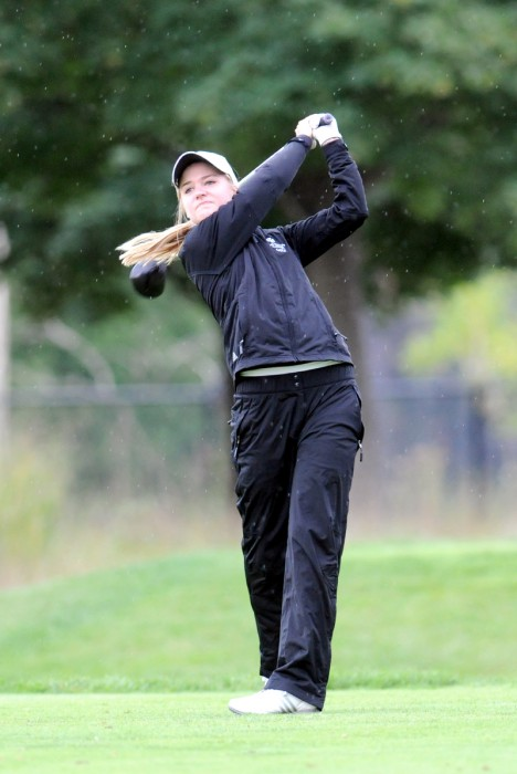 Belles' senior captain Paige Pollak tees off at the Warren Invitational Sep. 15, 2013.
