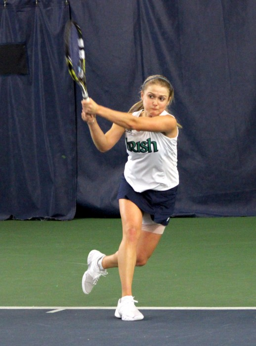 Irish freshman Mary Closs follows through after a shot against  Indiana on Feb. 2 at Eck Tennis Pavilion. The Irish won the match 4-3.