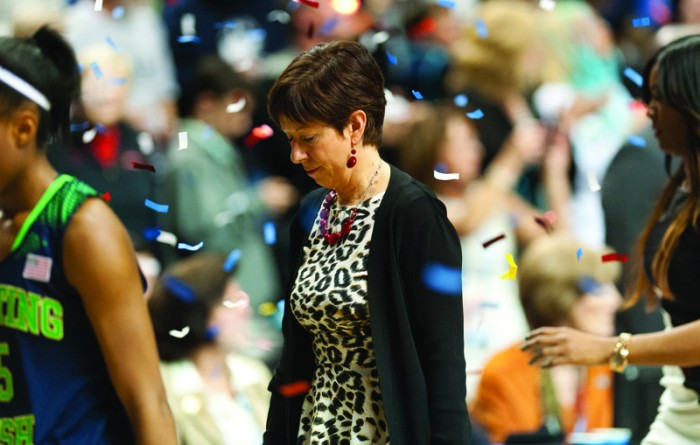 Irish coach Muffet McGraw exits the court under a shower of confetti after Notre Dame's 79-58 loss to Connecticut in the national championship game Tuesday at Bridgestone Arena in Nashville, Tenn. The defeat was Notre Dame's first of the season after entering the contest with a perfect 37-0 mark and brings the team's record in the Final Four to 5-5.