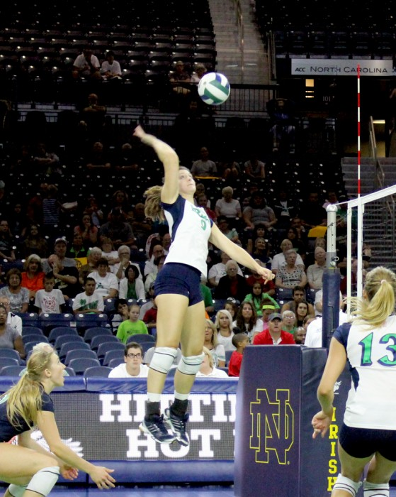 Irish graduate student outside hitter Nicole Smith goes up for a hit during an exhibition match against Polish club team Dabrowa on Sept. 8, 2013. Notre Dame lost, 3-0.