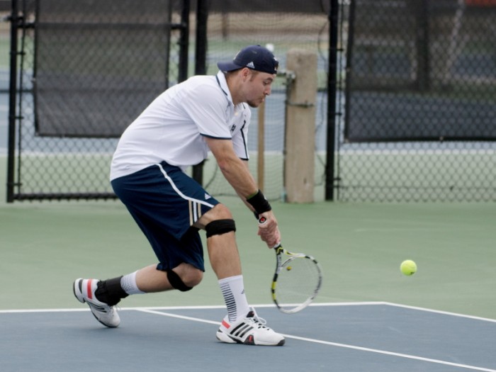 Senior Billy Pecor returns a hit during Notre Dame's match against Florida State on April 13 at Eck Tennis Pavilion. The Irish beat the Seminoles, 6-1, and Pecor won his doubles match, 8-5.