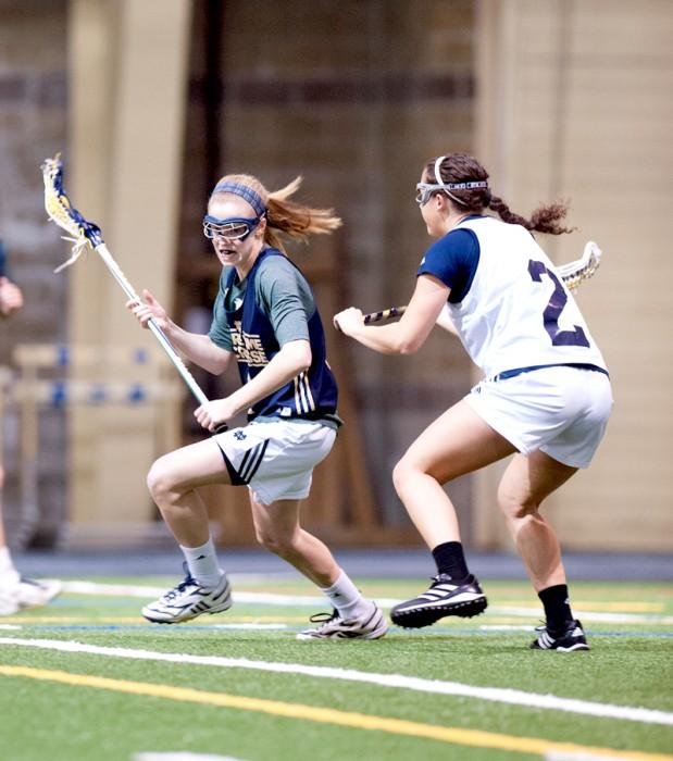 Sophomore attack Kiera McMullan tries to evade a Michigan              defender during Notre Dame's 19-7 exhibition win Feb. 8.