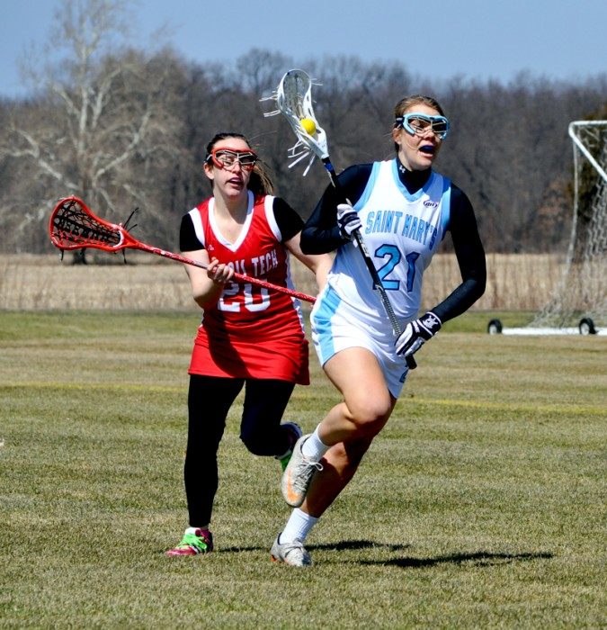 Saint Mary's sophomore defender Kristen Whalen eludes a defender during the Belles' 16-4 win over Illinois Tech on April 5.