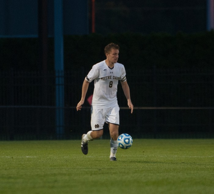 Irish senior midfielder Nick Besler pushes the ball down the field in a 5-1 exhibition win against Wisconsin on Monday at Alumni Field.