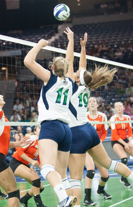 Irish senior outside hitter Meg Vonderhaar and senior middle blocker Jeni Houser attempt a block at the net against Bowling Green Sept. 6, 2013.