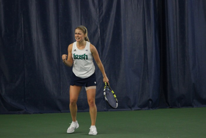Irish sophomore Monica Robinson celebrates after winning a point in Notre Dame's match against  Indiana on Feb. 2 at Courtney Tennis Center. Notre Dame defeated Indiana 4-3.