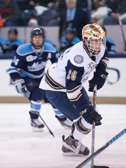 Irish junior center Steven Fogarty races down the ice Feb. 7 against during Notre Dame's 2-1 loss to Maine at Compton Family Ice Arena.