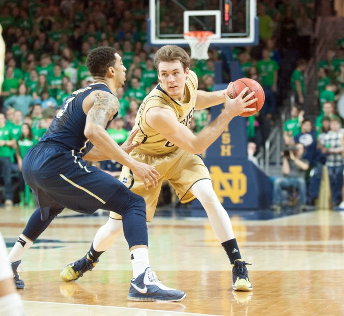 Irish senior forward/guard Pat Connaughton jukes out an opponent during Notre Dame's 85-81 loss to Pittsburgh on March 1.