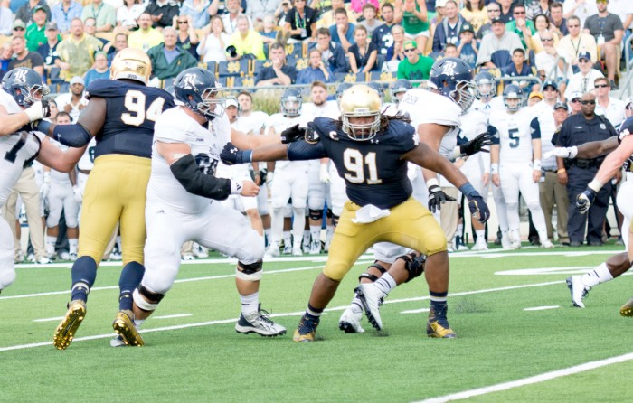 Irish senior defensive end and captain Sheldon Day works past his blocker in an attempt to get to the ball carrier during Notre Dame's 48-17 victory over Rice on Saturday.