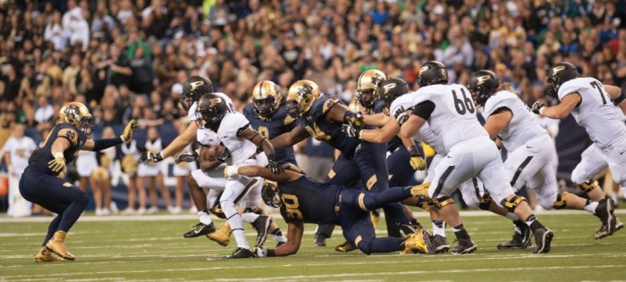 Irish sophomore defensive end Isaac Rochell clings to Boilermakers senior running back Akeem Hunt  during Notre Dame's 30-14 win Saturday in Indianapolis.