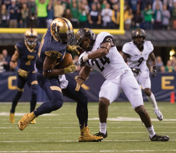 Irish junior receiver C.J. Prosise wrestles the ball away from Boilermakers junior defensive back Frankie Williams during Notre Dame's 30-14 win Saturday.