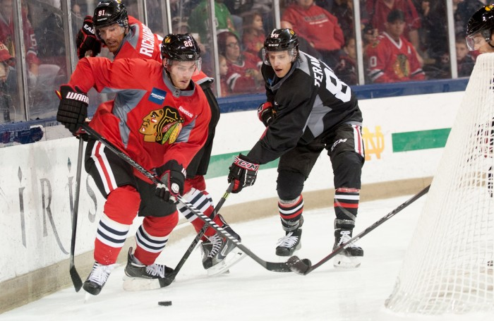 Blackhawks left wing Brandon Saad chases the puck behind the net Saturday at Chicago's practice at Compton Family Ice Arena.