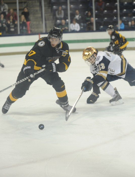 Irish sophomore center Vince Hinostroza stretches towards the puck during Notre Dame's 5-4 exhibition loss to Waterloo on Sunday.