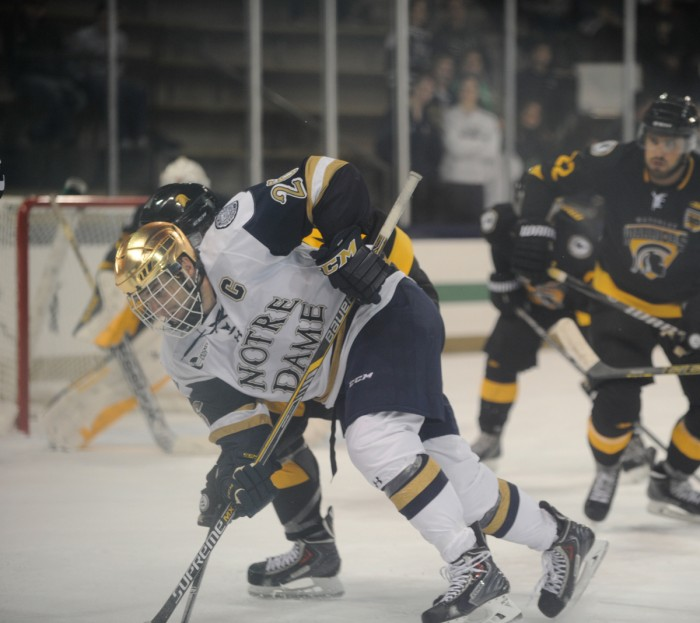 Irish junior center and captain Steven Fogarty fights for the puck in Notre Dame's 5-4 exhibition loss to Waterloo on Sunday at Compton Family Ice Arena. Fogarty won seven of 10 faceoffs in the game.