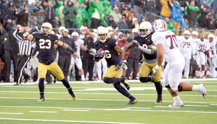 Freshman safety Drue Tranquill (left) sophomore cornerback Cole Luke (center) and sophomore linebacker Jaylon Smith celebrate after Luke's second interception during Notre Dame's 17-14 win over Stanford on Saturday.