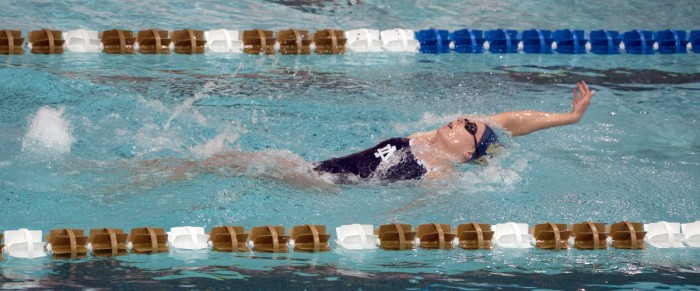 Irish junior Catherine Galletti swims the backstroke during a 219-60 win over Valparaiso on Nov. 15.
