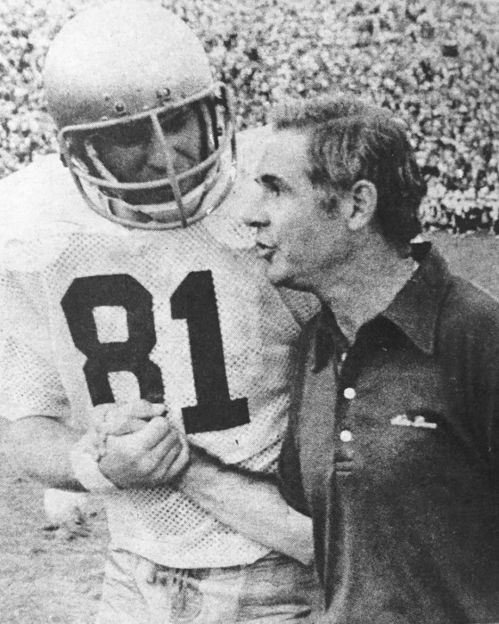 Former Notre Dame tight end Ken MacAfee shakes hands with Irish coach Dan Devine during the 1977 national championship season.