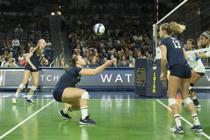 Irish senior middle blocker Jeni Houser digs a shot during Notre Dame's 3-1 loss to Duke on Sunday at Purcell Pavilion. Houser is second on the team in kills per set.