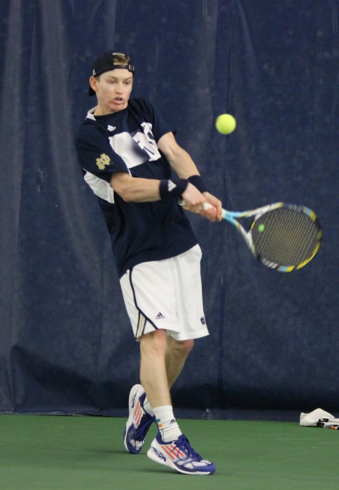 Irish sophomore Josh Hagar returns a backhand against Ohio State on Feb. 22 at the Eck Tennis Pavilion. Notre Dame lost the match 4-2.