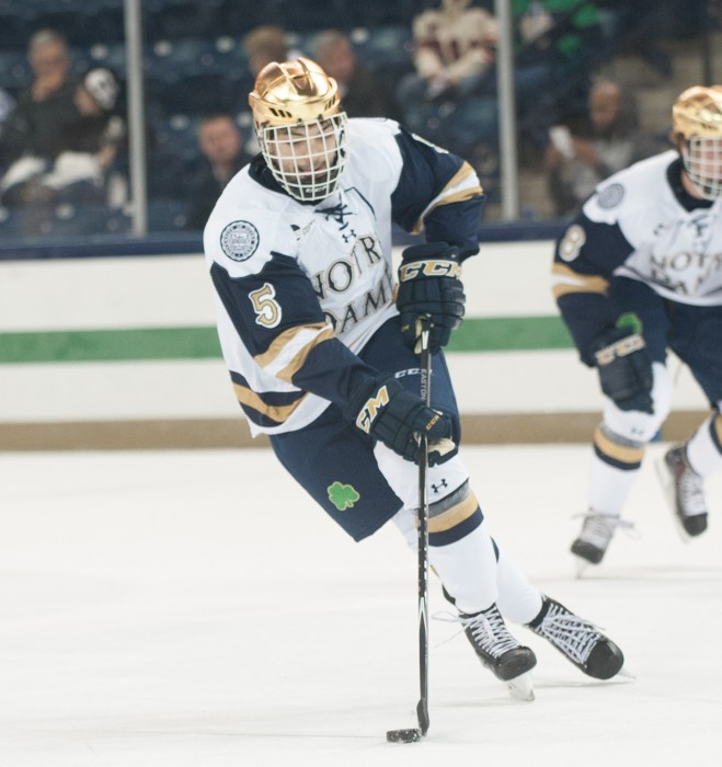 Irish senior defenseman Robbie Russo handles the puck while moving up ice Oct. 10 against Rensselaer at Compton Family Ice Arena. Rensselaer won 3-2.