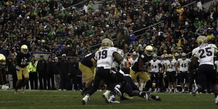 Navy junior quarterback Keenan Reynolds runs the option during Notre Dame's 38-34 win over the Midshipmen in last season's meeting at Notre Dame Stadium. The two teams meet again Saturday night at FedEx Field in Landover, Maryland.