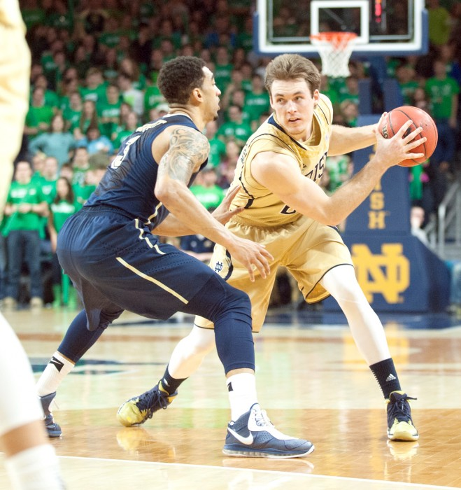 Irish senior/guard forward Pat Connaughton fakes out a Panther defender during Notre Dame's 85-81 loss to Pittsburgh on March 3.